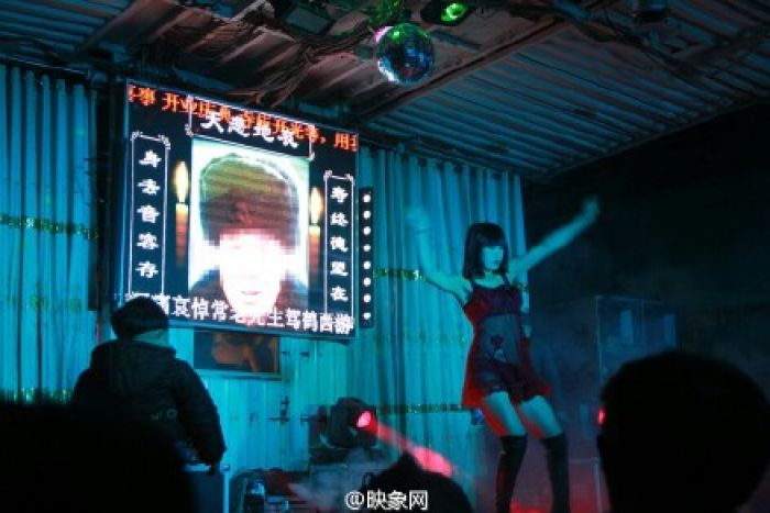 Strippers Provide Comfort and Lap Dances For Funeral Mourners In China